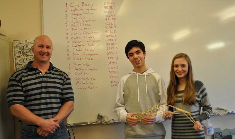 by: SUBMITTED PHOTO - Physics teacher Mark Wechter, Cole Bemis and Kate Hollingshead pose following a bridge contest triumph.