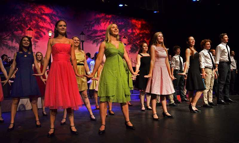 by: REVIEW FILE PHOTO: VERN UYETAKE - Lakeridges top-tier show ensemble performs a major annual concert, calling it Tonight! last year, a show in which the boys wore ties and girls donned brightly colored frocks. The ensemble is putting on its big show again this April.