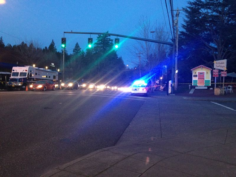 by: CONNECTION PHOTO: DREW DAKESSIAN - Portland police were on scene at Capitol Highway and Sunset Boulevard Wednesday evening.