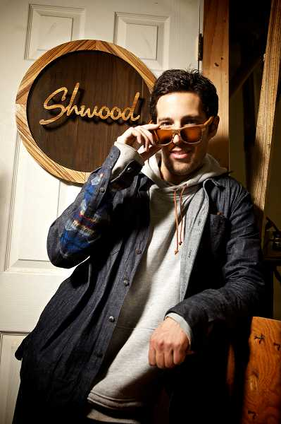 by: TIMES PHOTO: JAIME VALDEZ - Eric Singer, founder of Schwood sunglasses, launched his Beaverton business in 2009.