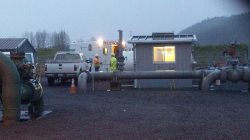 by: FILE PHOTO - Crews work to shut off an emergency release valve on a natural gas transfer station on Sauvie Island Jan. 10.