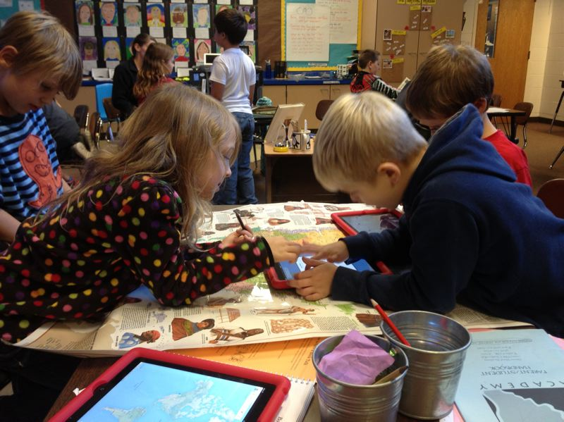 by: SUBMITTED PHOTO - Students In Asa Gervich's thrid-grade class at Sauvie Island Academy use iPads, among other learning devices, during a lesson.