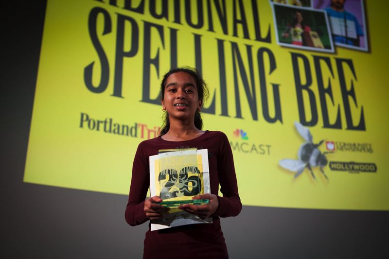 by: TRIBUNE PHOTO: ADAM WICKHAM - Beaverton middle schooler Divya Amirtharaj, 12, successfully spelled the words Sophoclean and armamentarium to win the 2014 Portland Tribune/Comcast Regional Spelling Bee. She also was the 2013 winner.