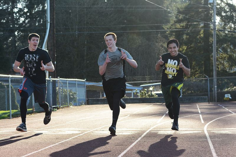 by: JOHN WILLIAM HOWARD - Seniors Tanner Long and Gage Bumgardner, along with sophomore Kyle Reuge, let off a little steam during track practice in a silly moment on Tuesday, March 11. All three played together on the basketball team.