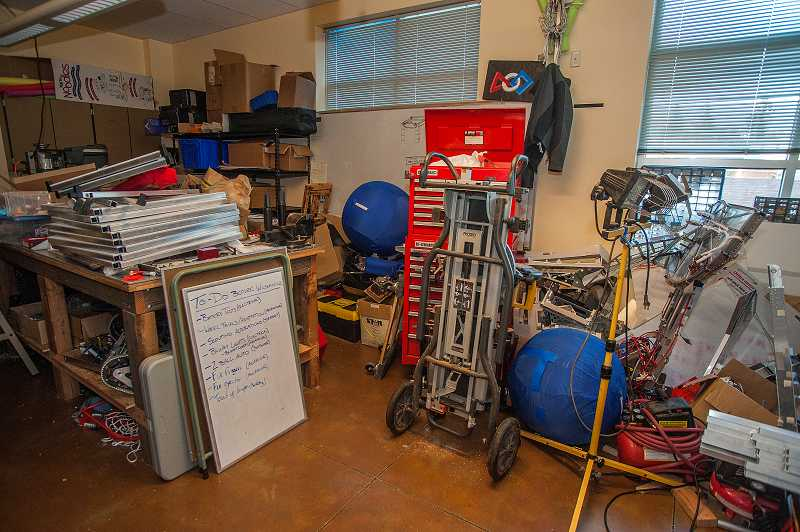 by: SPOKESMAN PHOTO: JOSH KULLA - This small, crowded storage room in the Wilsonville High School cafeteria is the home of the schools robotics team and equipment - even the to-do list (bottom left).