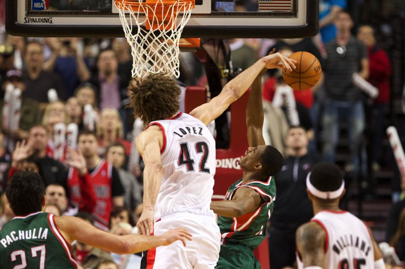 by: TRIBUNE PHOTO: JAIME VALDEZ - Trail Blazers center Robin Lopez blocks a layup attempt by Brandon Knight of the Milwaukee Bucks.