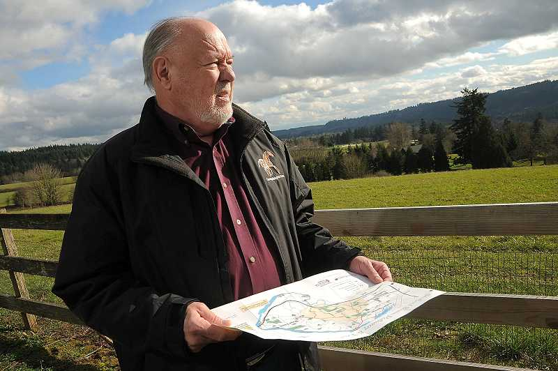 by: TIDINGS FILE PHOTO: VERN UYETAKE - The Stafford areas future remains up in the air as West Linn, Tualatin and Lake Oswego continue to fight against its urban reserve designation. Here, resident Tom Lackman looks out at the Stafford Hamlet, where he views eventual development to be inevitable.