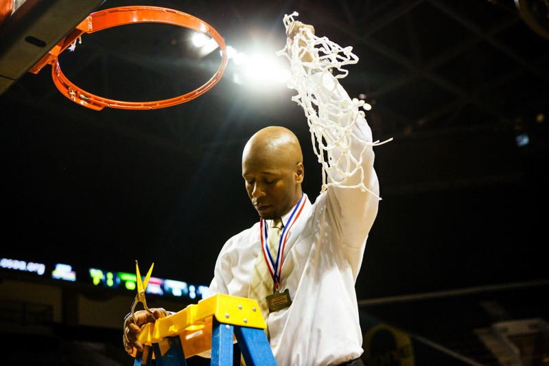 by: COURTESY OF IVAR VONG - Jefferson coach Pat Strickland cuts the final piece of the net after the Democrats 69-64 victory over Churchill.
