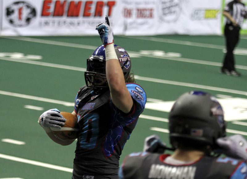 by: TRIBUNE PHOTO: JONATHAN HOUSE - Bryce Pella of the Portland Thunder celebrates an interception in Mondays franchise-opening game, a 64-34 loss at home to the San Jose SaberCats.