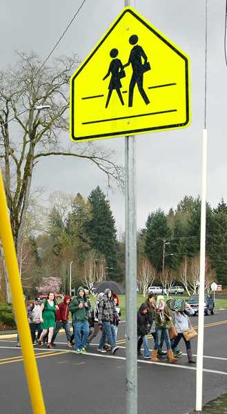 by:  ISABEL GAUTSCHI - Is it safe enough? Three students were struck by a car as they traversed this crosswalk between the junior high and high school on Wednesday, March 12. Luckily, none were seriously injured, but the incident has prompted an outpouring of concern.