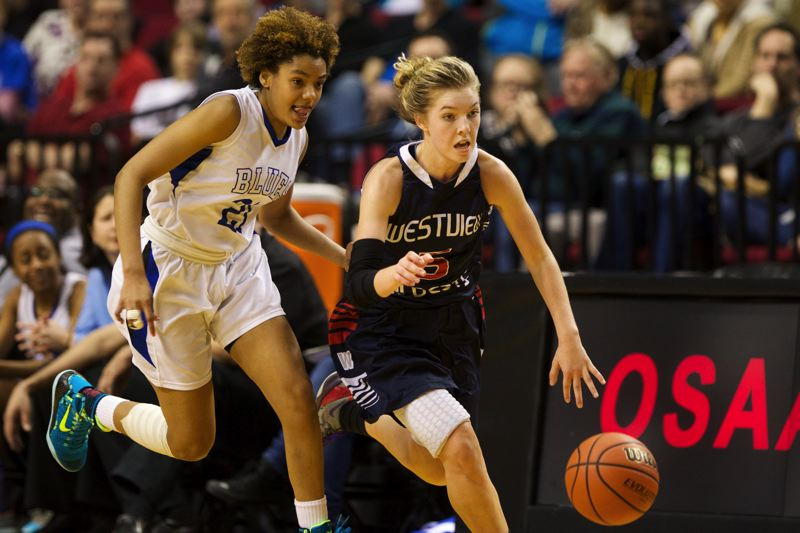 by: TIMES PHOTO: JAIME VALDEZ - Westview Wildcats Ashley Scoggin brings the ball up court against St. Marys Academy Blues Tasia Bilbrew in the second half of the 6A girls quarterfinals at Moda Center.
