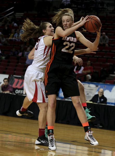 by: TIMES PHOTO: JONATHAN HOUSE - Beaverton's Dagny McConnell comes down with the ball against Clackamas.