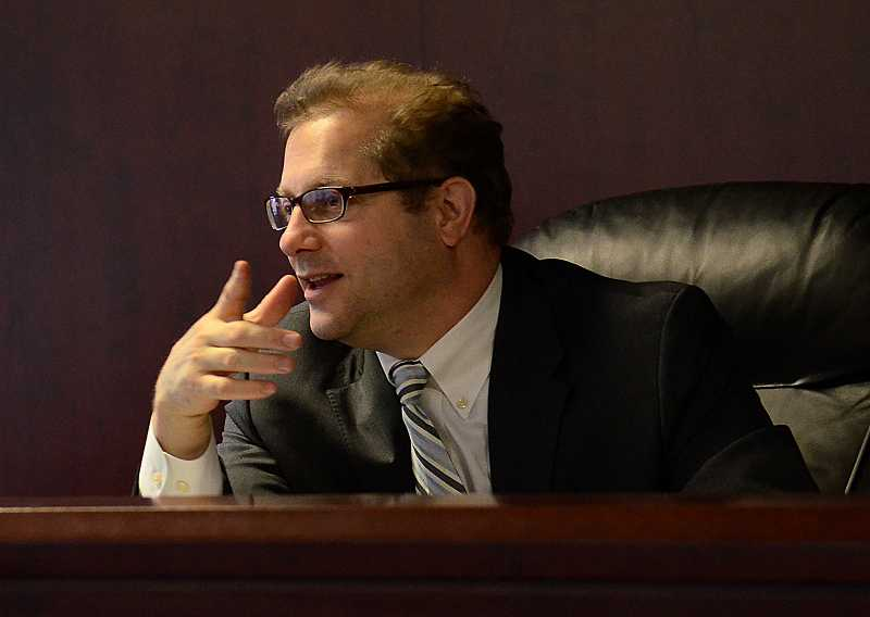 by: REVIEW PHOTO: VERN UYETAKE - Attorney Matt Levin is one of the Lakeridge mock trial teams coaches.