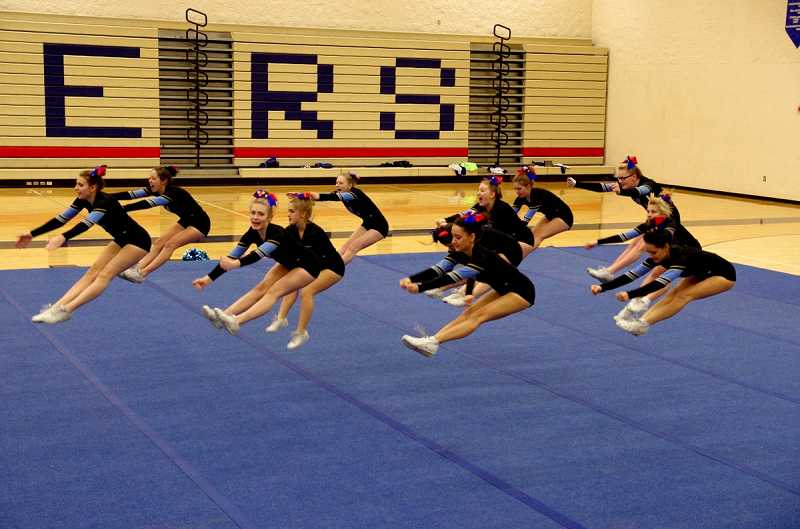 by: SUBMITTED PHOTO: CHRIS BUHLMANN - Lakeridge High cheerleaders showcase their moves at a recent event.