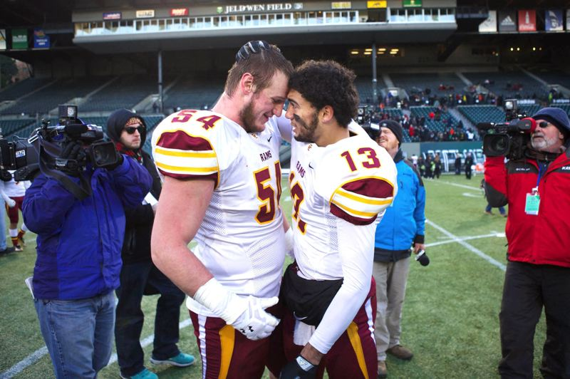 by: PAMPLIN MEDIA GROUP: FILE PHOTO - Central Catholics Connor Humphreys, left, celebrates last years 6A state title with Rams QB Aidan Wilder.