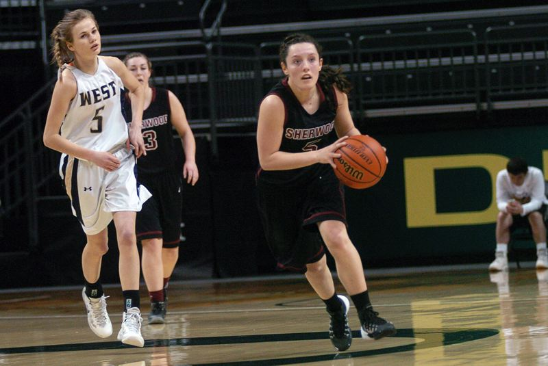 by: DAN BROOD - ON THE MOVE -- Sherwood sophomore guard Taylor Corno (right), in front of West Albany's Saylor Siegner, looks to get the ball up court in a hurry in last Thursday's game at the Class 5A girls basketball state tournament in Eugene.