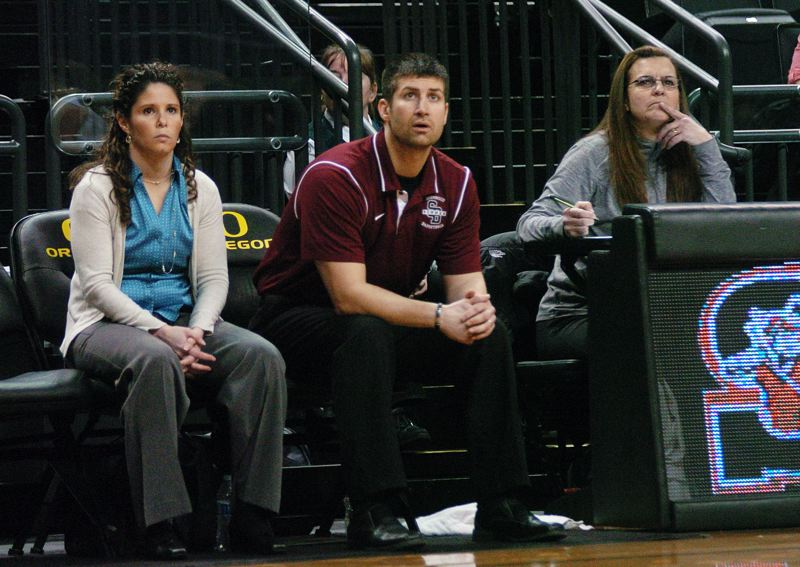 by: DAN BROOD - TAKING IT IN -- Sherwood head coach Wes Pappas and assistant Cindy Olvera (left) watch the action during last Thursday's game at the Class 5A state tournament.