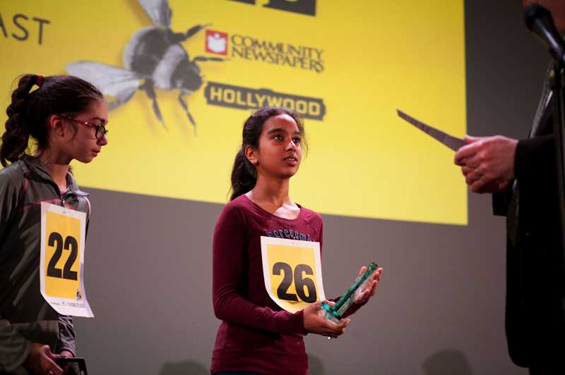 by: TIMES PHOTO: JAIME VALDEZ - Divya Amirtharaj, center, became only the fourth repeat champion in 10 years of the Portland Tribune/Comcast Regional Spelling Bee on Saturday at the Hollywood Theatre in Northeast Portland.