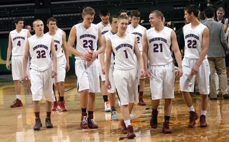 by: DAN BROOD - STILL GOING -- The Bowmen walk off the court following their state tournament win over Bend.