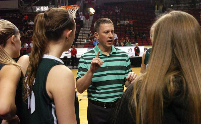 by: DAN BROOD - GETTING READY -- Tigard coach Steve Naylor talks to his team prior to the start of last week's quarterfinal game at the Class 6A state tournament.