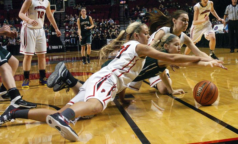 by: DAN BROOD - FIGHTING FRESHMAN -- Tigard freshman Kylie Warren dives for the ball between a pair of Oregon City players in last week's state tournament game at the Moda Center.