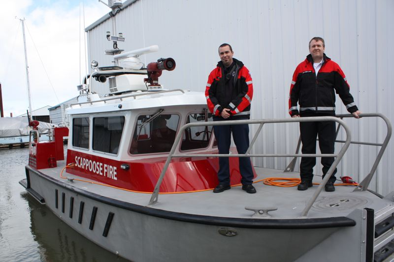 by: SPOTLIGHT PHOTO: ROBIN JOHNSON - Scappoose Rural Fire District Lt. Josh Marks and Division Chief Chris Lake stand aboard the districts new 30-foot aluminum jet boat, which they say should be ready for service within a month.