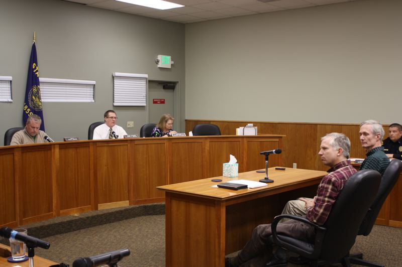 by: SPOTLIGHT PHOTO: ROBIN JOHNSON - Barry Sims and Scott Ferguson of Trout Mountain Forestry explain to the Scappoose City Council their approach to  attracting more bidders for clear-cutting a 30-acre tract of timber in the Gourlay Creek Watershed.