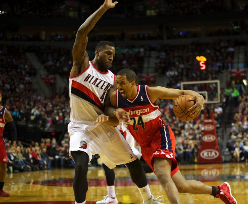 by: TRIBUNE PHOTO: JAIME VALDEZ - Thomas Robinson (left) of the Blazers defends Washington guard Andre Miller.