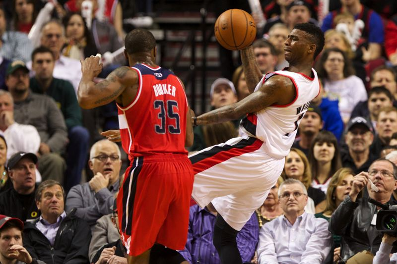 by: TRIBUNE PHOTO: JAIME VALDEZ - Blazers forward Dorell Wright (right) tries to save the ball from going out of bounds against Wizards forward Trevor Booker.