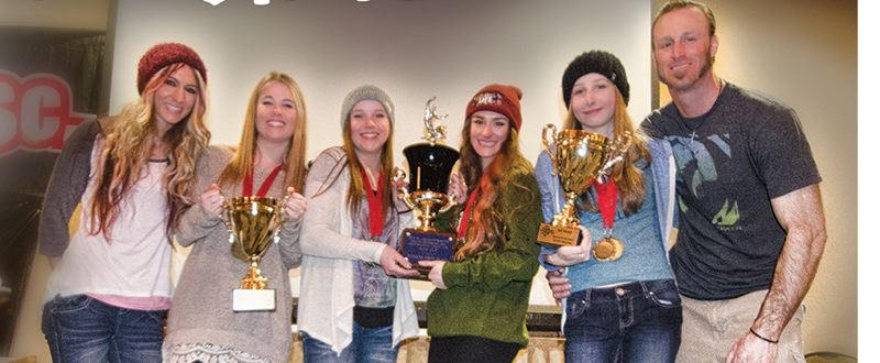 by: SUBMITTED - Members of Oregon City High Schools state championship snowboarding team pose proudly with their hardware from the 2014 state championships. Pictured are (from left) coach Kelly Clasen, Callie Sweet, Megan Brawn, Sierra Clasen, Shaye Verbanac and coach Chris Clasen.