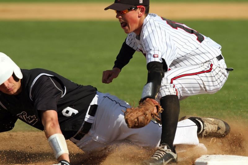 by: JON HOUSE - Oregon City coach Greg Lord is counting on senior Clay Valenzuela-Reece to lead a youthful Oregon City baseball team to success this spring. A three-year starter, Valenzuela Reece is playing shortstop for the Pioneers this year, after catching last year. Valenzuela-Reece is pictured playing third base and making the tag on Thurstons Stefan Drake in 2012, when the Pioneers beat the Colts in the state-title game.