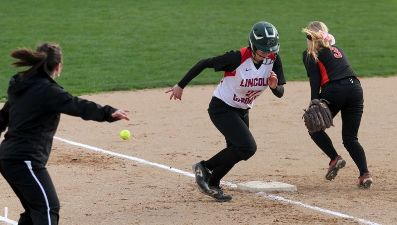 by: TRIBUNE PHOTO: JONATHAN HOUSE - Lincoln High's Maggie Clapp makes a run for home after a missed throw to third base by Beaverton. The Cardinals won the nonleague game 13-11 at Delta Park last week.