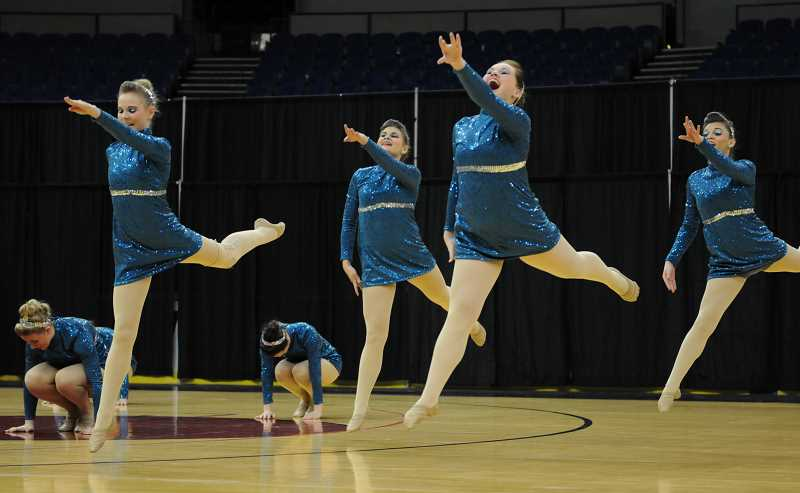 by: LON AUSTIN/CENTRAL OREGONIAN - The Crook County High School Sparkles dance and drill squad perform at the OSAA Class 4A/3A/2A/1A State Dance and Drill competition on Saturday in Portland. The Sparkles came away from the competition with a fifth place finish. From left, Maddie Woodward, Karli Tooley, Savannah Connell, and Gracie Carpenter leap during Saturday's final performance.