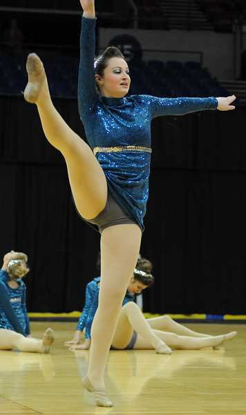 by: LON AUSTIN/CENTRAL OREGONIAN - Jordan Rutz dances during the Sparkles, performance at state. The Sparkles finished fifth with a score of 78.86. Stayton won the competition with a score of 91.31, while Valley Catholic took second with a score of 84.47.
