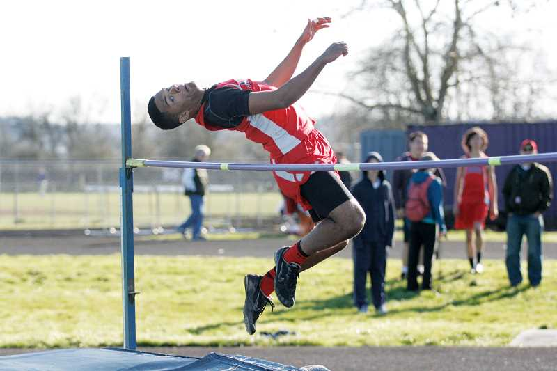 by: PHIL HAWKINS - Freshman Bishop Mitchell cleared 5-foot-8 to take first place in the high jump on March 18 at Jefferson High School.