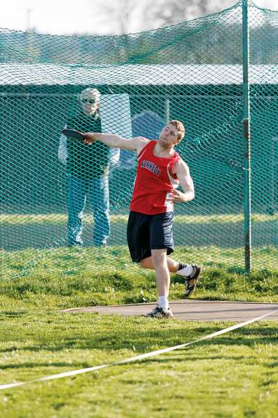 by: PHIL HAWKINS - Daniel Glaede's mark of 111-3 in the discus was just enough to edge teammate Jesus Conejo for first. Glaede went on the place first in the shot put and javelin as well.