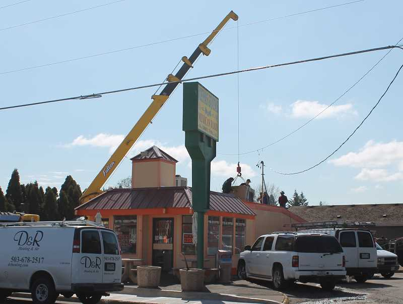 by: CORY MIMMS - Workers install new heating and air conditioning at Molalla's Muchas Gracias.
