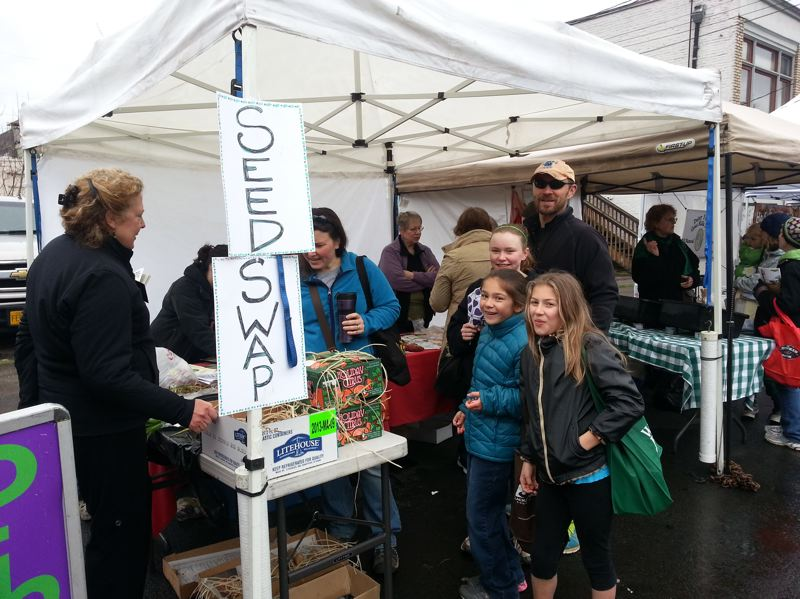 by: PHOTO COURTESY: JACKIE HAMMOND-WILLIAMS - At last year's Seedy Saturday at the Oregon City Farmers Market, customers bring seeds saved or left over from prior seasons to share with neighbors.