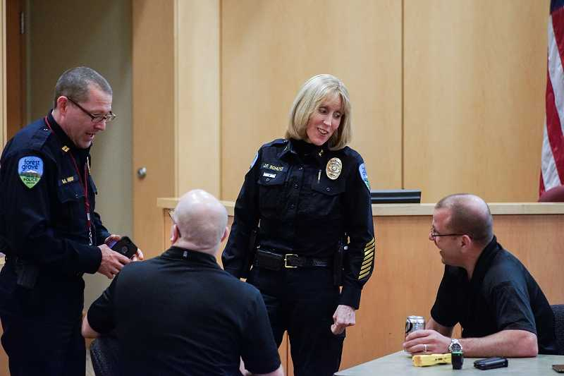 by: NEWS-TIMES PHOTO: CHASE ALLGOOD - Police Chief Janie Schutz says she works with a great set of people whose different personalities balance each other out. Among them is colleague Mike Herb.