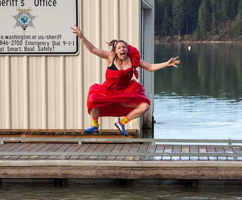 by: NEWS-TIMES PHOTO: PATRICIA GARNER - Misty Lewis of Forest Grove donned a red prom dress for her plunge into Hagg Lake last week as a way to raise money for the National Alzheimers Association. In all, 47 area residents jumped into the lake during a social media-driven challenge last week.