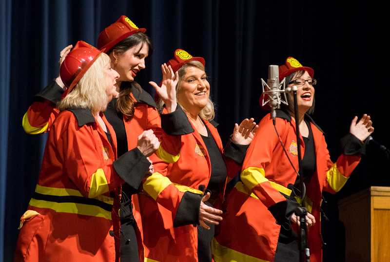 by: NEWS-TIMES PHOTOS: CHASE ALLGOOD - The ladies of Aspire -- Alena Menefee, Amy Rose, Linda Muldowney and Connie Alward -- donned firefighter garb to blaze through the finalist competition Saturday, where their group placed third.