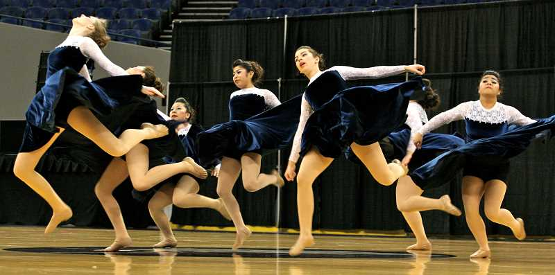 by: BRIAN MONIHAN - Woodburn Hi-Liners perform their routine at Saturday's state competition.