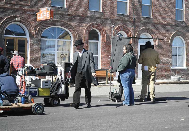 by: SUBMITTED PHOTO - The crew sets up for filming in front of the Shaniko Hotel.
