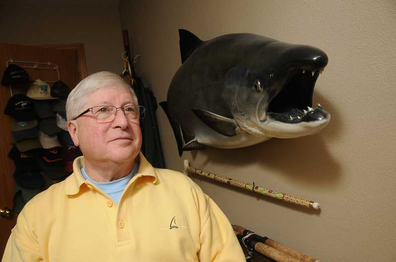 by: PAMPLIN MEDIA GROUP: VERN UYETAKE - Dennis Richey is an avid supporter of fisheries and anglers with prized fish replica mounted on one wall of his home.