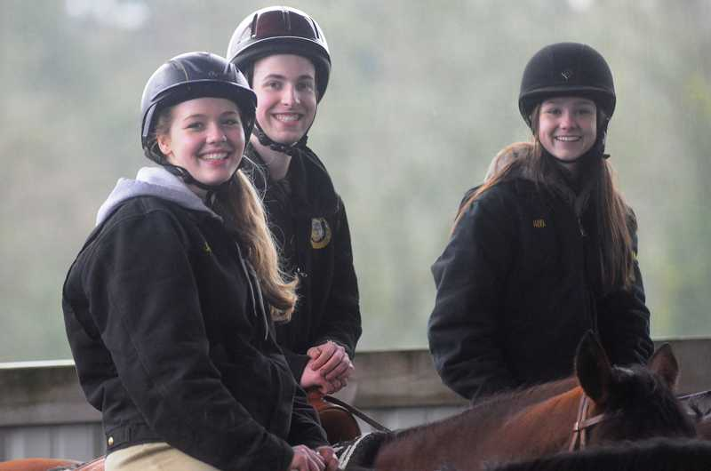 by: PAMPLIN MEDIA GROUP: MATT SHERMAN - Jessica Hughes, Issac Wilkinson and Alli Sloop take a break from a recent equestrian practice in Wilsonville. The three are all talented competitors for West Linn's equestrian team this year.