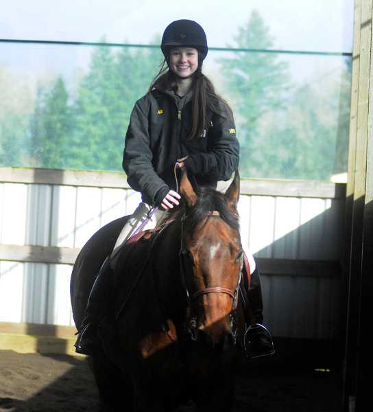 by: PAMPLIN MEDIA GROUP: MATT SHERMAN - West Linn sophomore Alli Sloop warms up with her horse, Buddy, before practicing her equestrian events.