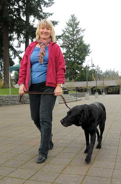 by: PAMPLIN MEDIA GROUP: VERN UYETAKE - Marilyn Lewis started volunteering for Guide Dogs for the Blind shortly after moving to Lake Oswego in 2010.