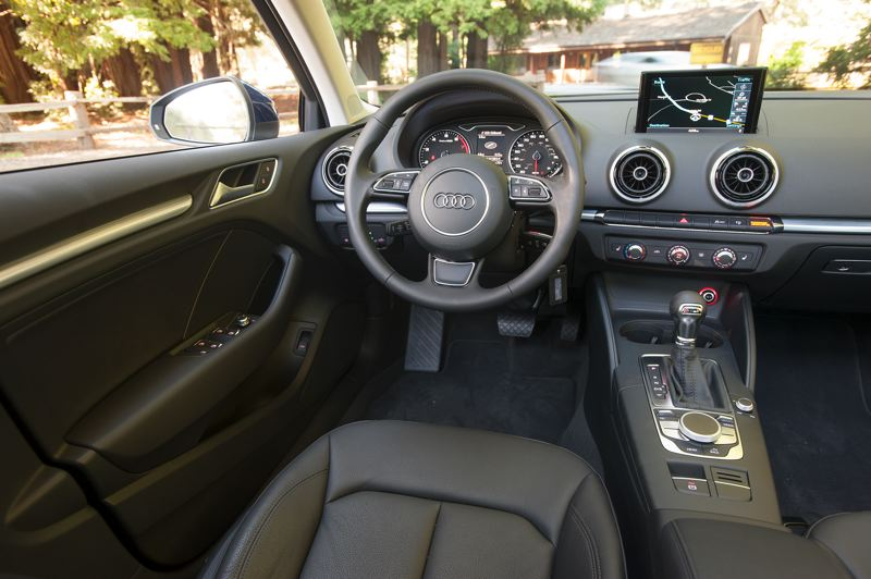 by: JOHN M. VINCENT - The 2015 Audi A3's navigation screen rises electrically from a thin slot in the top of the dash.