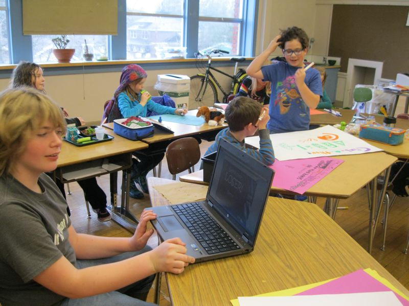 by: PHOTO COURTESY OF CATHERINE BECKETT - Elementary students work on posters to publicize Clime-a-Thon to raise money for  350.org.