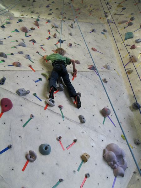 by: PHOTO COURTESY OF CATHERINE BECKETT - Dylan Beckett practices for fundraiser at rockclimbing gym.